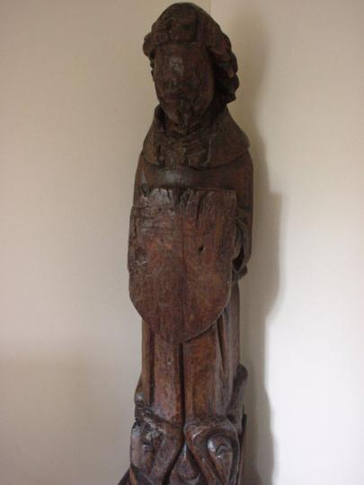 English medieval oak roof angel defaced in antiquity