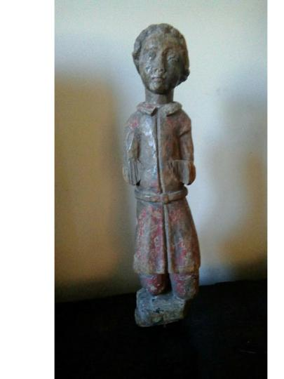 English fifteenth century oak carving of a young boy