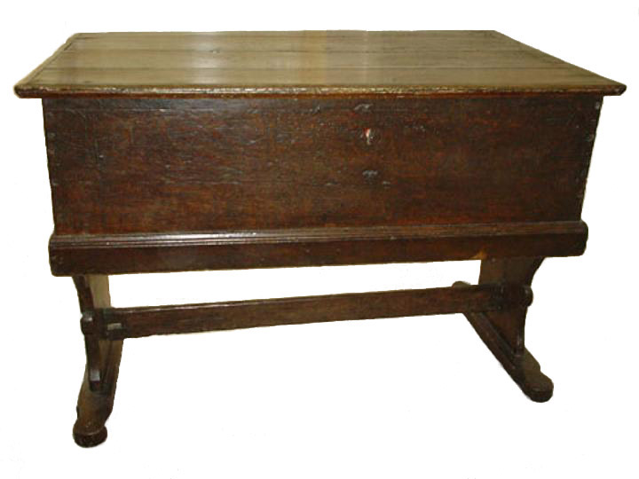 English early sixteenth century oak planked decorated counter table