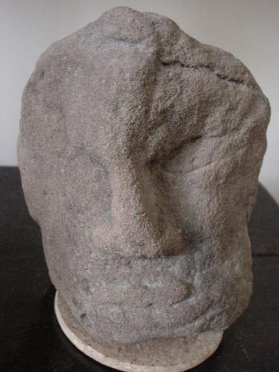 English medieval sandstone head from the archivolt of a door or window