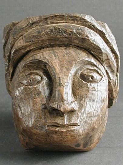 English thirteenth century oak carved head of a carpenter