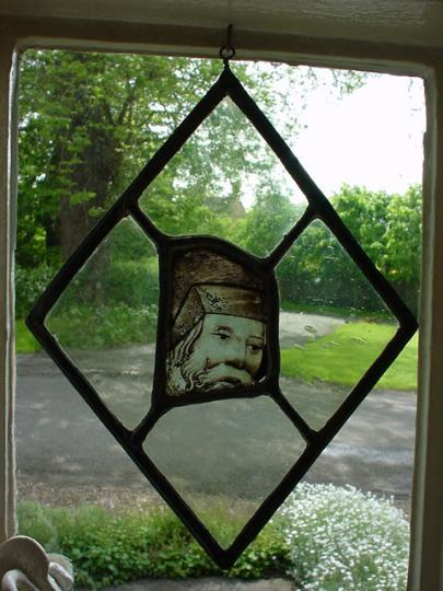 A piece of English fifteenth century glass from Norwich depicting the head of a man