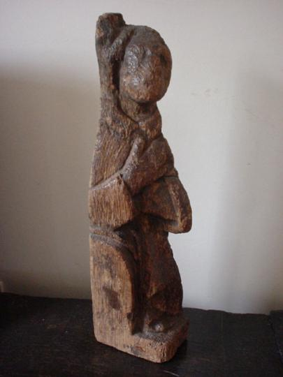 Northern French or English pre Conquest or early medieval oak staircase finial of a monk on a bench