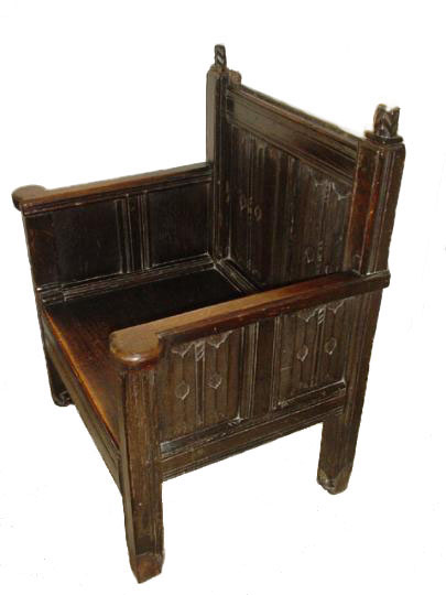 English fifteenth century oak linenfold panelled armed chair formerly animalier footed