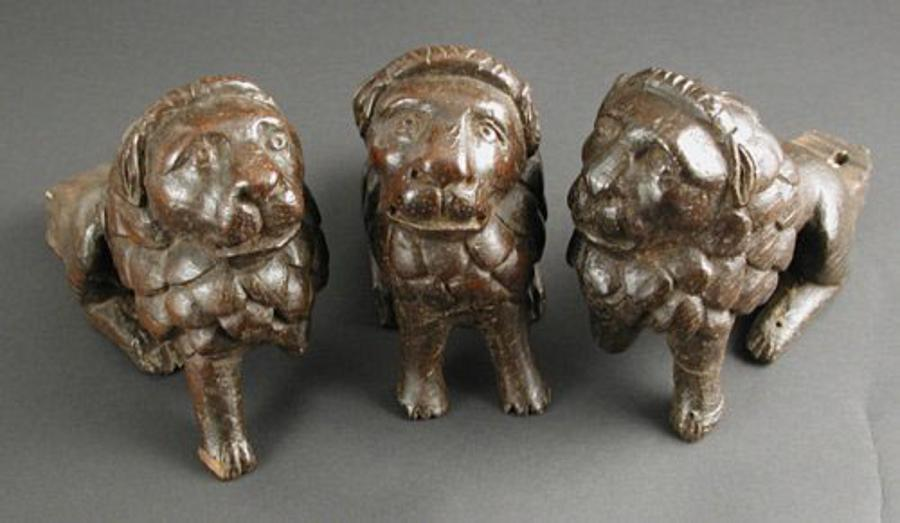 English fifteenth century oak carvings of lions from the feet of a lectern