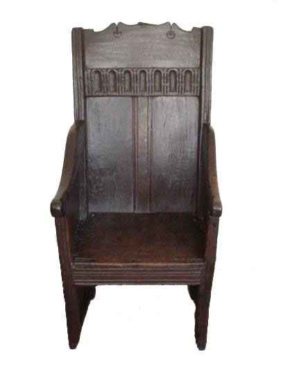 English fifteenth century oak enclosed panelled armed chair